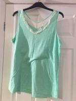 Light green vest top size 18 with white lace trim