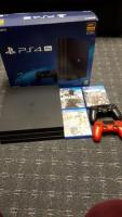 ps4 pro 1TB with 2 controllers and 3 games