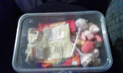 small tub of sweets with chocolate