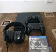 Sony PS4 1tb with 2 controllers headset and modernwarfare