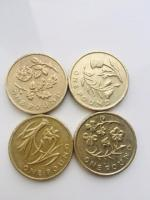 Old 1 pound coins flower floral.