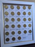 Old 1 pound coins set of 28 with photo frame.