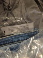 Woman's chewed hemmed jeans
