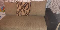 Sofa with footrest and swivel