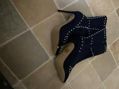 Blue high heel boots with pearl deactivated details