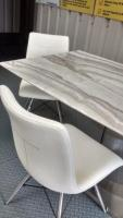 white and grey marble effect dining table with a stainless steel stand with 4 chairs