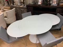 circular extending dining table and chairs