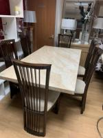 cream marble effect dining table and chairs