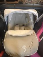 Sliver cross pram and sliver cross car seat and 2 baby walkers and a baby seat