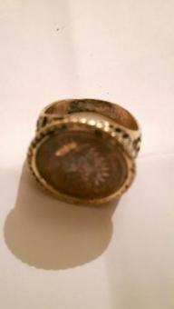 coin ring gold coloured